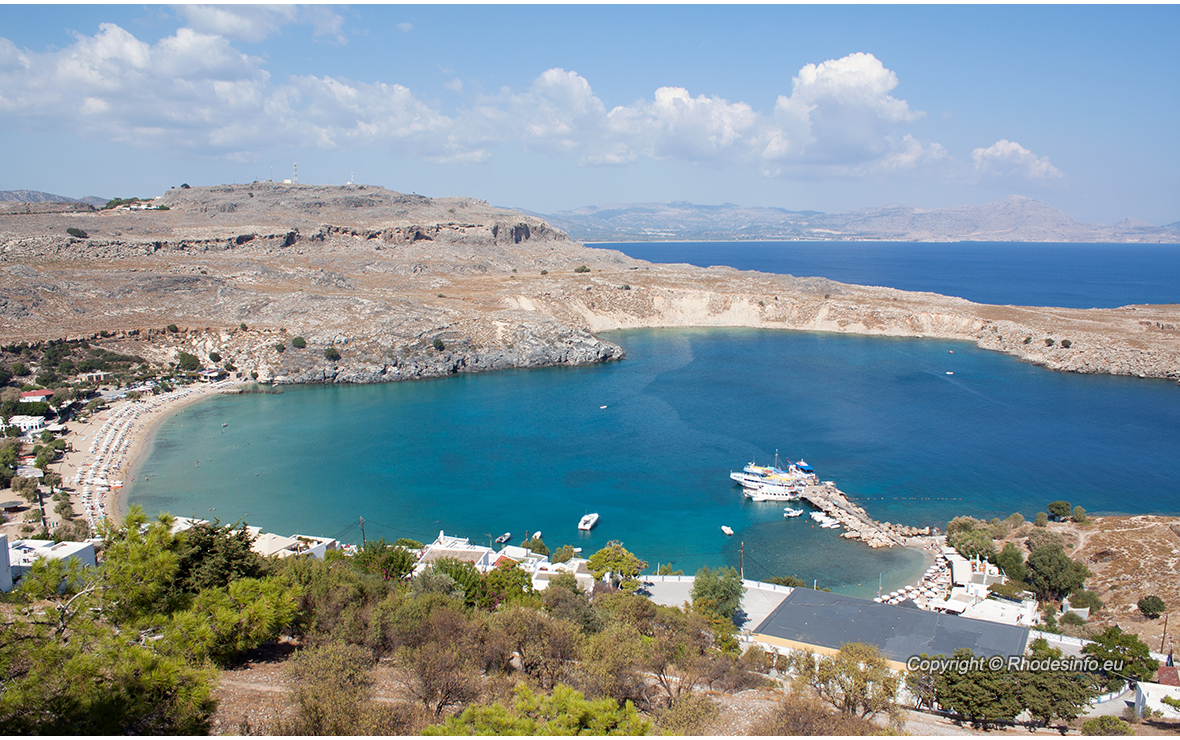 View from above of the main beach in Lindos, Rhodes, one of the Dodecanese Islands in the Aegean Sea, Greece.